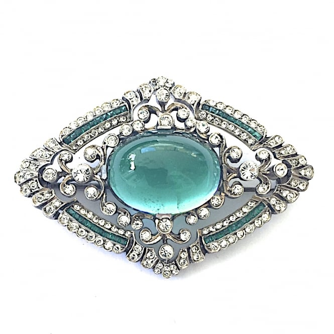1920's French silver and finely set clear and emerald paste brooch with a large cabochon stone in the centre