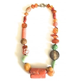 Necklace with a large coral bead at centre with amber, agate and jade with a silver clasp length 56 cms