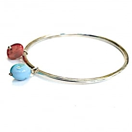 Silver bangle with a Mediterranean coral bead and a turquoise bead. bangle diameter 6.2 cms