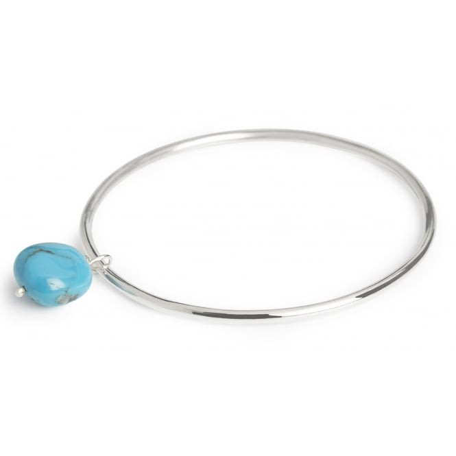 Turquoise bead from New Mexico suspended from a silver bangle diameter 6cms